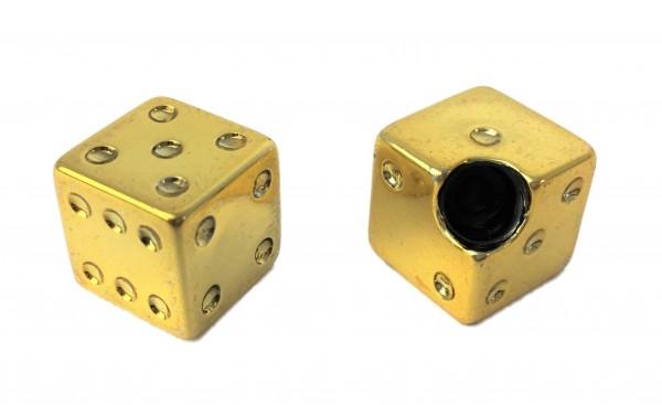 Tapas de válvula en forma de dado dorado sobre punta